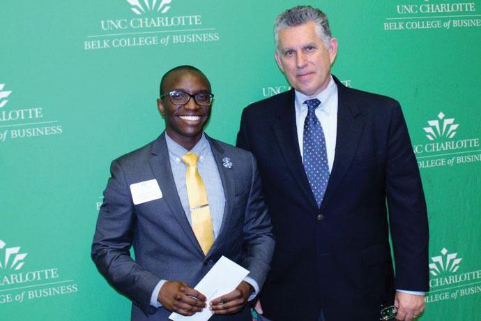 John Lechko (right), president of the Carolinas Chapter, presented the TEI Carolinas Chapter scholarship to accounting student Jonathan Brown.